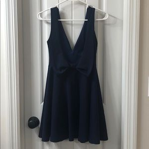 Backless navy blue cocktail dress with bow detail